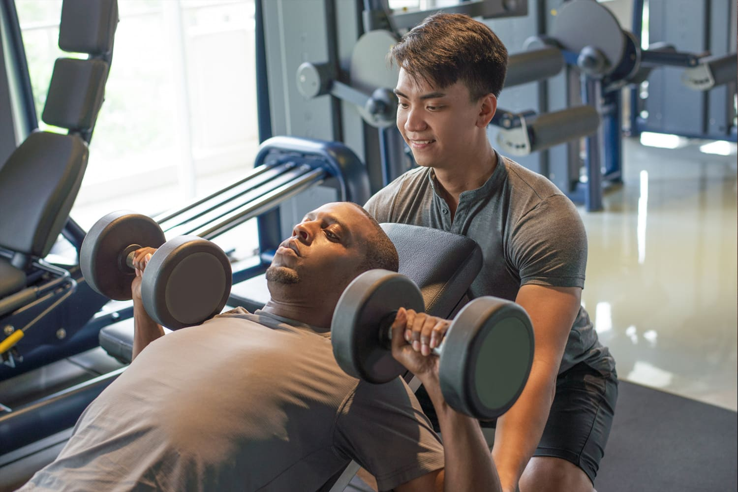 man helping to weight lift